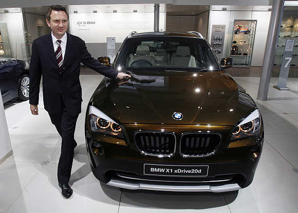 Peter Kronschnabl, President of BMW India, with BMW X1 xDrive20d in New Delhi.
