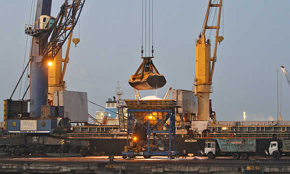 A crane unloads fertiliser from a cargo ship at Mundra Port in Gujarat.