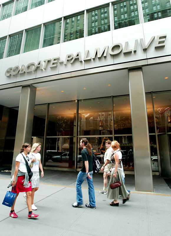 People pass the entrance of Colgate-Palmolive World Headquaters in New York City.