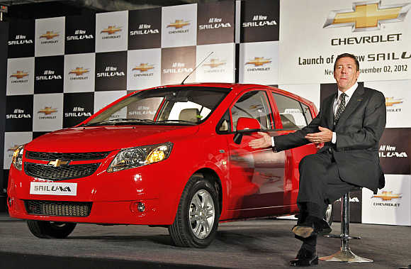 Lowell Paddock, President and Managing Director, General Motors India, with Chevrolet Sail U-VA car in New Delhi.