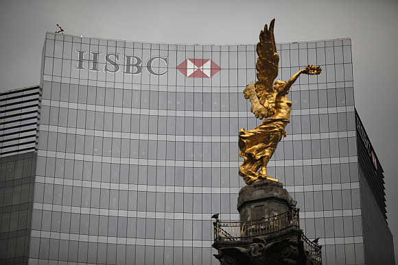 The Angel of Independence monument stands in front of HSBC's headquarters in Mexico City.