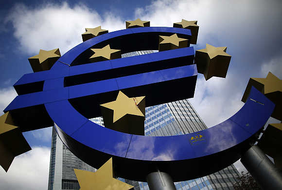 Euro currency sign is seen in front of the European Central Bank headquarters in Frankfurt.