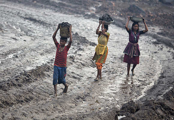 Labourers carry coal from an open cast coal field in Dhanbad, Jharkhand. Photo is for representation purpose only.
