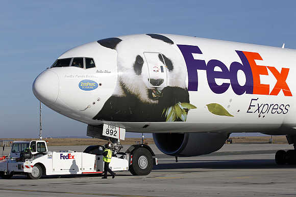 FedEx Panda Express aircraft carrying two giant pandas taxis along the runway at the Charles-de-Gaulle airport near Paris.