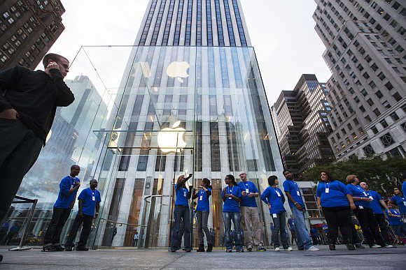 Employees line up outside the Apple Store on Fifth Avenue in New York.