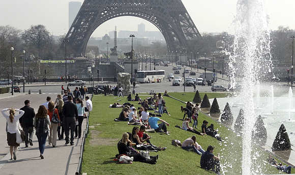 People relax at Trocadero square near the Eiffel tower in Paris.