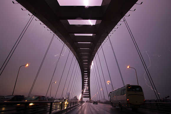 A lightning bolt illuminates the sky above Lupu Bridge in Shanghai.