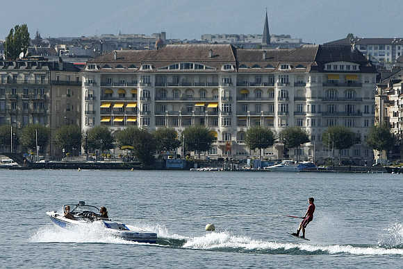 A wakeboarder performs on Lake Leman in Geneva.
