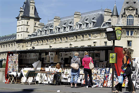 View of Paris' antique booksellers or bouquinistes along the banks of the river Seine.