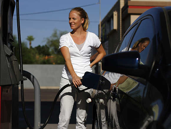 A motorist pumps fuel into her vehicle in Phoenix, Arizona.