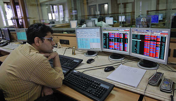 A broker monitors share prices at a firm in Mumbai.