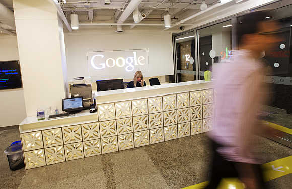 A man walks by the reception desk at the Google office in Toronto.