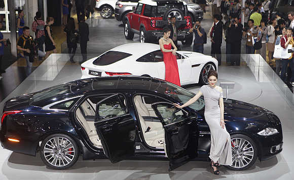 Jaguar cars are displayed at Auto China 2012 in Beijing.