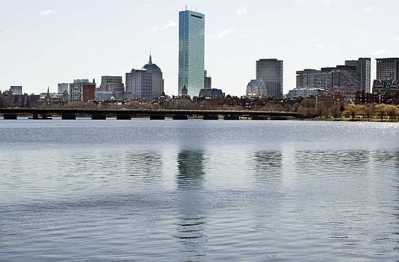 John Hancock Tower is seen from across the Charles River in Cambridge, Boston.