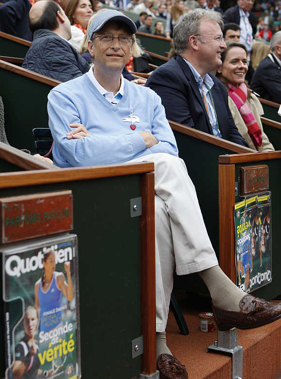 Bill Gates watches the women's final at Roland Garros in Paris.