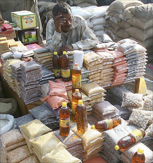 A salesman waits for customers at a grocery wholesale market in Chandigarh.