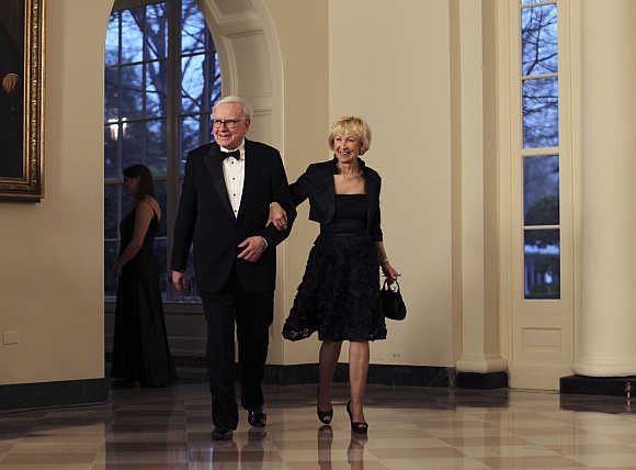Warren Buffett with his wife Astrid Menks at the White House in Washington, DC.