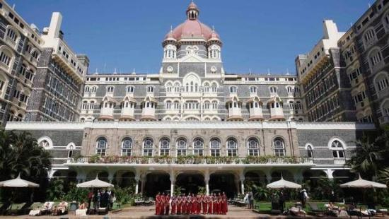 Staff of the Taj Mahal Palace hotel pose in Mumbai