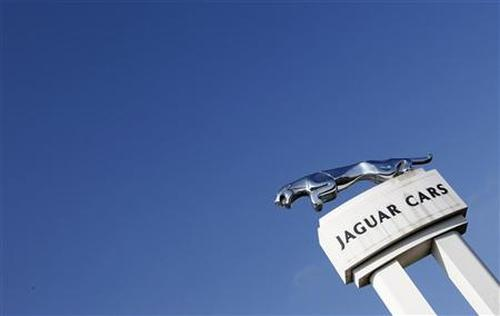 A Jaguar symbol is seen outside the Jaguar Land Rover's Halewood assembly plant in Liverpool