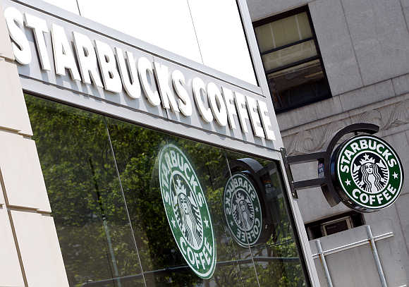 Starbucks signs are seen outside one of its stores in New York.