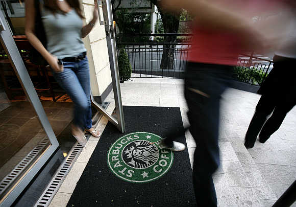 Starbucks customers walk out of store on Sao Paulo's Alameda Santos, Brazil.