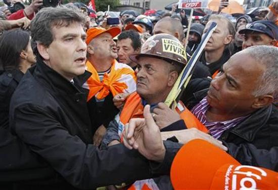 France's Minister for Industrial Recovery Arnaud Montebourg (L) talks to ArcelorMittal workers from Florange after a meeting with trade union representatives at the town hall in Florange, Eastern France