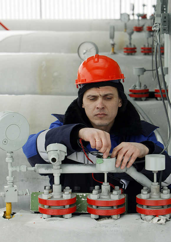 A Gazprom technician works at the gas export company's Sudzha compressor station in Russia.