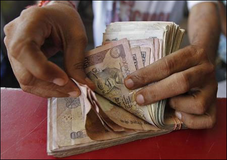 Rupee up 61 paise, ends at 2-wk high
