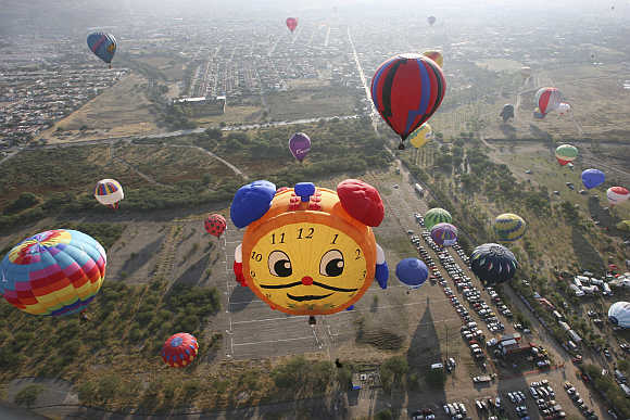 Hot-air balloons fly over the Metropolitano park during the International Hot-Air Balloon Festival in Leon in the Mexican state of Guanajuato.