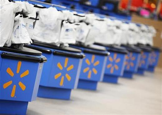 The Wal-Mart logo is pictured on cash registers at a new store