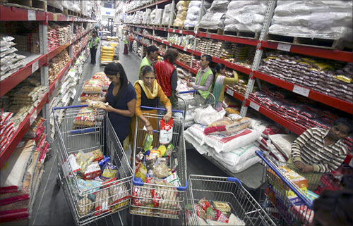 Customers shop inside a Best Price Modern Wholesale store, a joint venture of Walmart Stores Inc and Bharti Enterprises, at Zirakpur, Punjab.