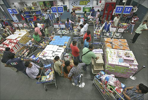 Customers wait to pay for their goods at a Best Price Modern Wholesale store, a joint venture of Walmart Stores Inc and Bharti Enterprises, at Zirakpur, Punjab