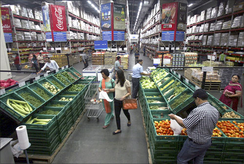 Customers shop at a Best Price Modern Wholesale store, a joint venture of Wal-Mart Stores Inc and Bharti Enterprises, at Zirakpur.