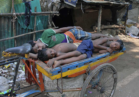 Villagers take a nap in Jagatsingpur district in Orissa.