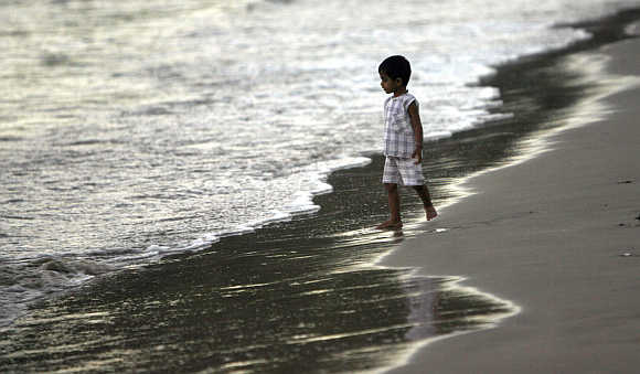 A child walks on a beach in Port Blair.