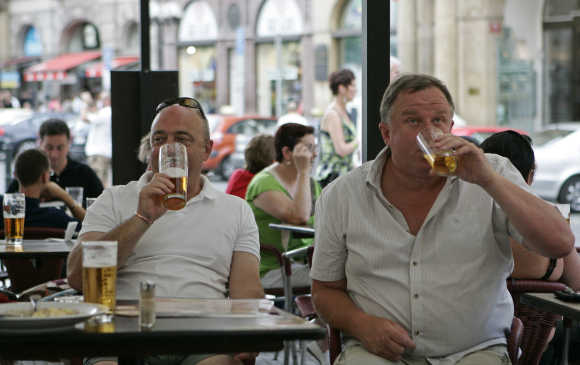 British tourists drink beer in central Prague.