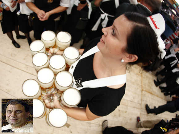Karan Billimoria, inset. A waitress serves beers during the opening ceremony of the Oktoberfest in Munich.