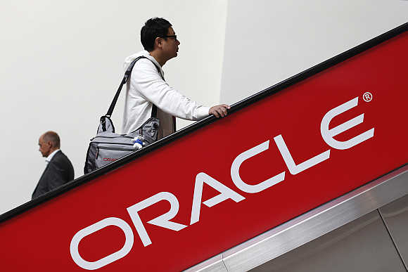 Two attendees ride an escalator during Oracle OpenWorld 2012 in San Francisco.
