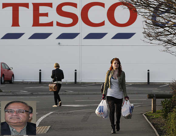 Devashish Mitra, inset. A shopper leaves a Tesco store in Loughborough, central England.