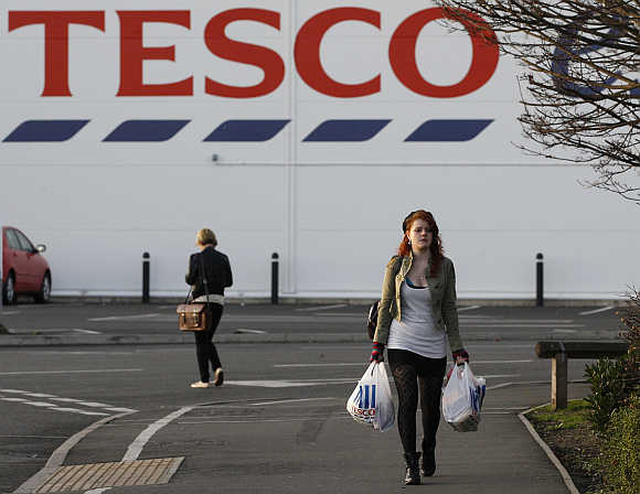 A shopper leaves a Tesco store in Loughborough, central England.