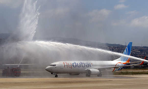 Flydubai is sprayed with water at Beirut international airport.