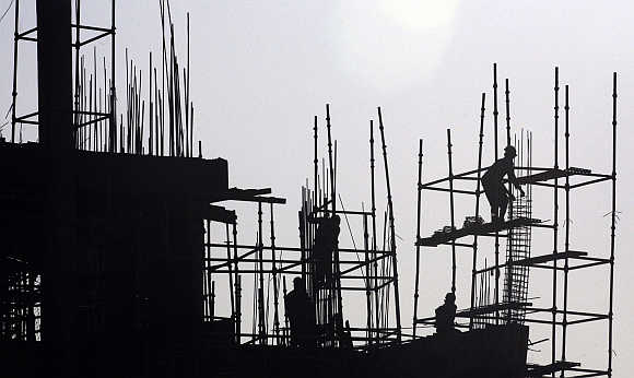 Labourers work at construction site in Chandigarh.