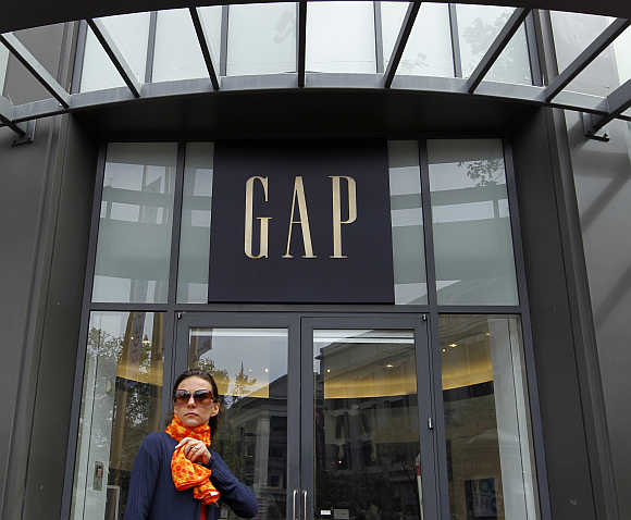 A woman walks past the Gap flagship store in San Francisco.