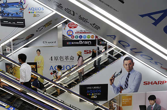 Advertisements for Sharp are seen at an electronics shop in Tokyo.
