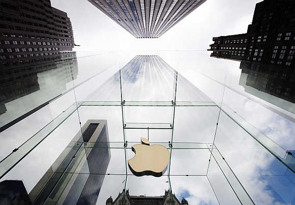 Apple logo hangs in a glass enclosure above the Fifth Ave Apple Store in New York.