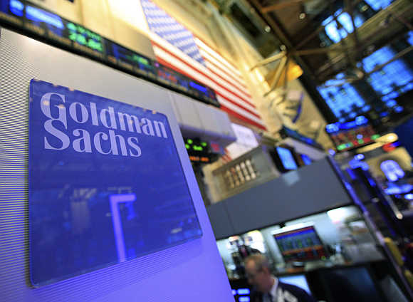 A Goldman Sachs sign is seen on at the company's post on the floor of the New York Stock Exchange.