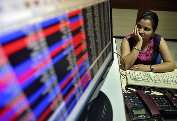 An investor watches the share index in Chandigarh.