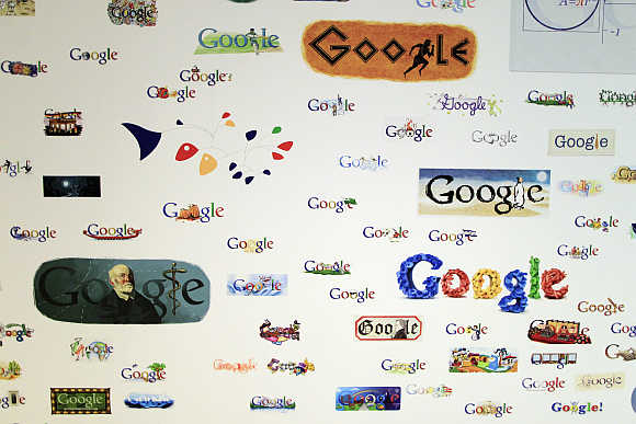Google homepage logos are seen on a wall at the campus near Venice Beach in Los Angeles.