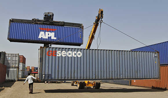 Mobile cranes prepare to stack containers at Thar Dry Port in Sanand, Gujarat.