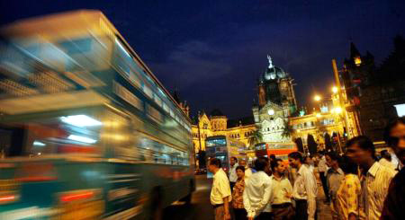 A bus speeds past Chhatrapati Shivaji Terminus in Mumbai